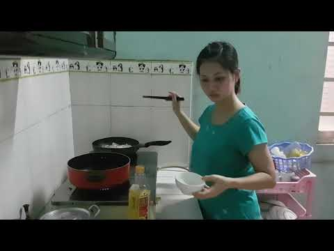 Asia beautiful housewife was preparing dinner