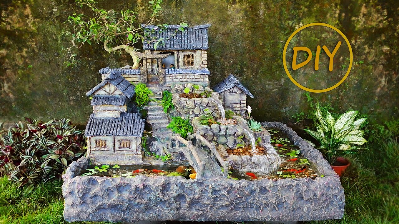 WOW! Very excellent waterfall aquarium with house on the mountain from sryrofoam