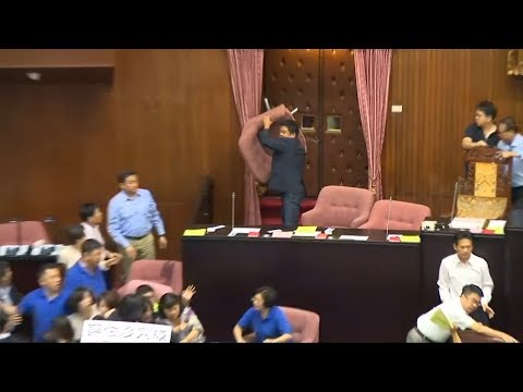 Taiwanese parliament broke out into a water balloon and chair-throwing brawl