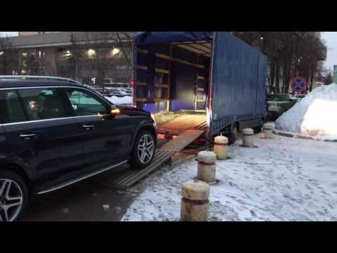 Крытый эвакуатор по России. Перевозка автомобилей крытыми эвакуаторами Смарт-карго.
