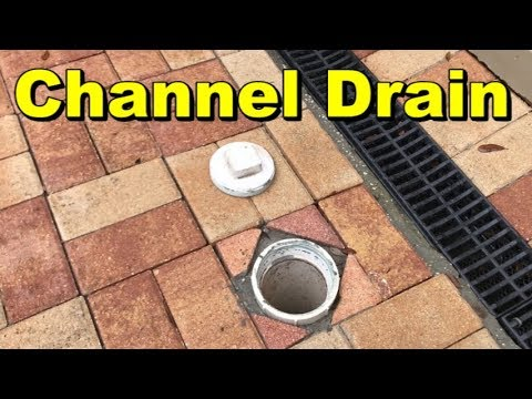 Channel Drain with New Back Yard Sump Basin, Driveway and Pavers