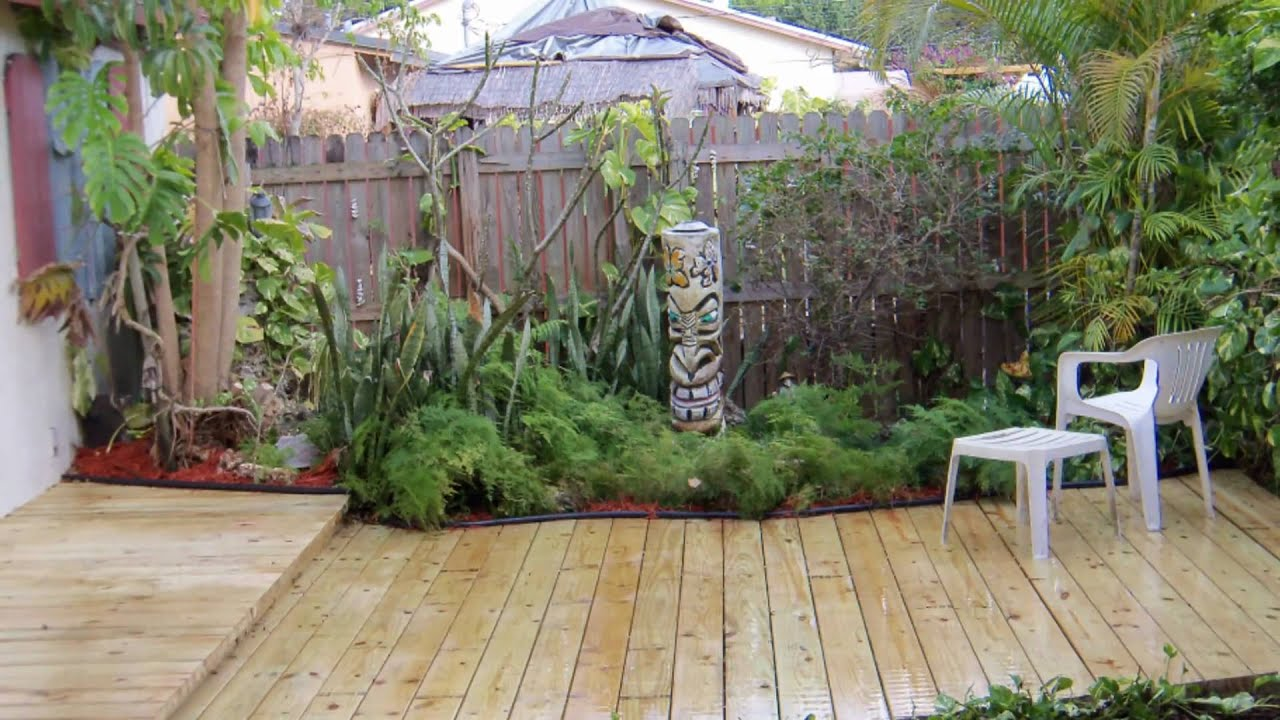 Garden deck with fish pond youtube for Fishpond uk