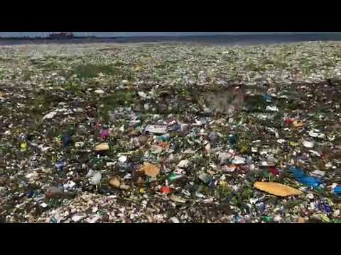 GARBAGE  WAVES  ON A DOMINICAN REPUBLIC BEACH