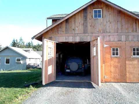Automatic carriage garage door opener youtube for Swing out garage doors price