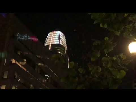 Salesforce Tower San Francisco Giant Figurine Dancing At Top, 1,000 Feet Up, At Night