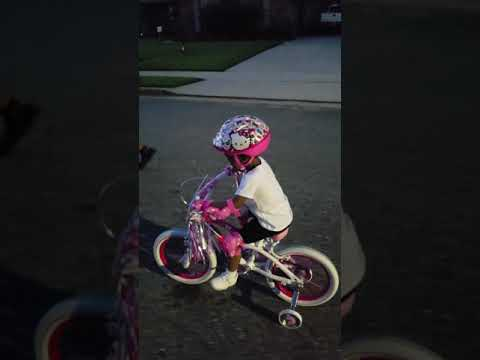 Addy 1st bike ride with helmet and pads