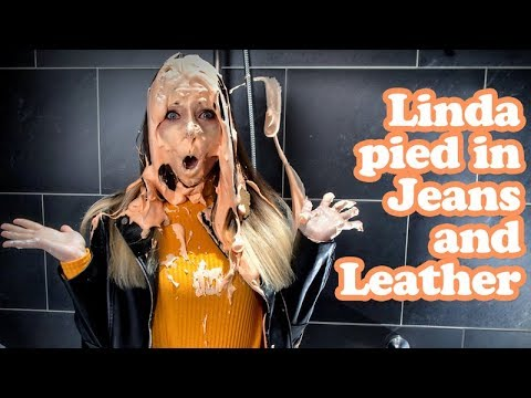 Linda is pied and slimed in Jeans and Leather