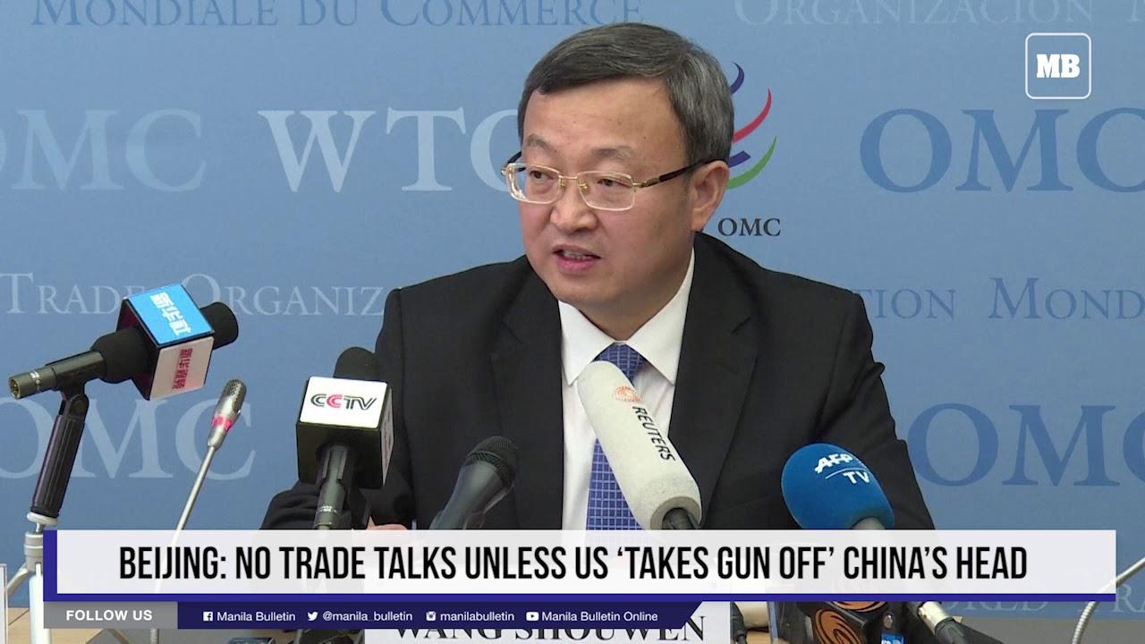 Beijing: No trade talks unless US 'takes gun off' China's head