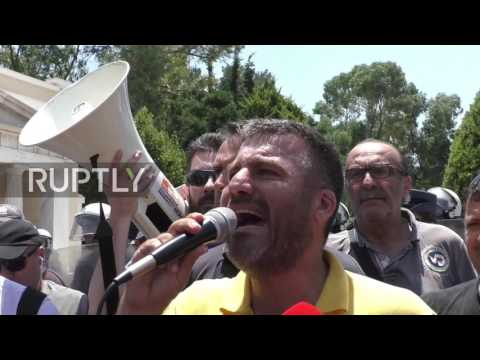 Greece: Scuffles outside parliament, rubbish dumped at MOI as job losses loom