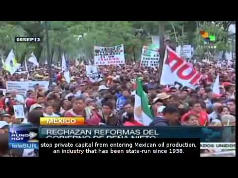 Thousands march in Mexico City to reject energy and tax reform