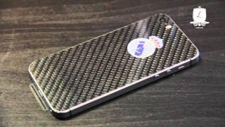 iPhone 5s со светящимся логотипом «Реал Мадрид», отделка карбоном.