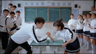 Arm wrestling contest. Who lost had to wear black stockings to school.