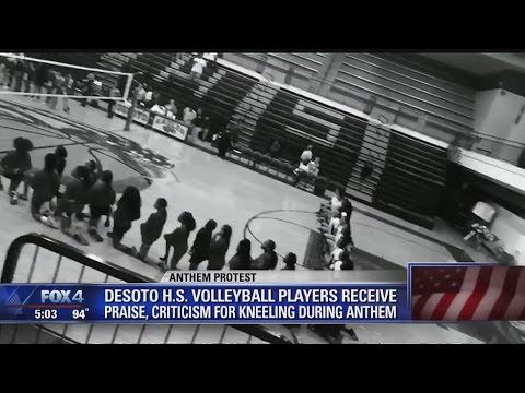 DeSoto High School volleyball team kneels during national anthem