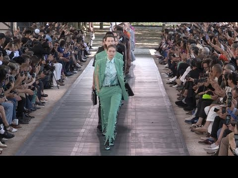 Gigi Hadid and fellow models on the runway for the Berluti Fashion Show