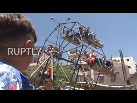 Syria: Aleppo children celebrate Eid al-Fitr for first time since city's liberation