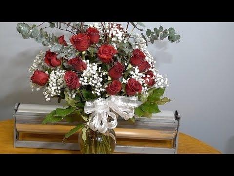 Arranging two dozen roses in a vase
