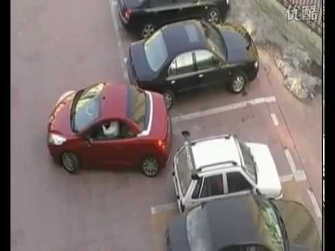 Girl Gets Stuck Between Two Cars