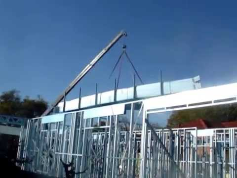 Building a new house - Lifting steel frames with a crane