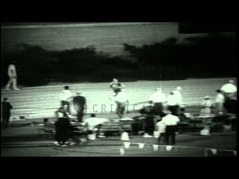 Jim Ryun breaks his own world record in the mile at the AAU Championships in Bake...HD Stock Footage