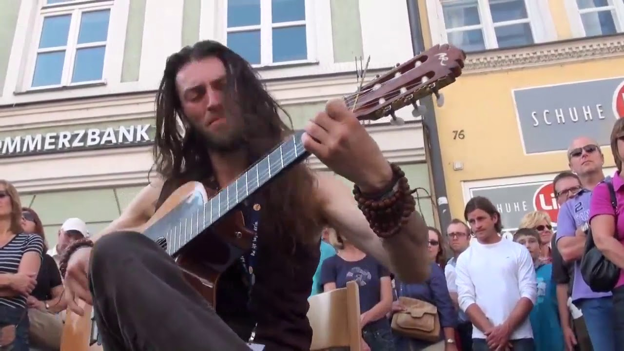 Best Street Guitar Performance Hundreds flock to watch this street performer and you can see why!