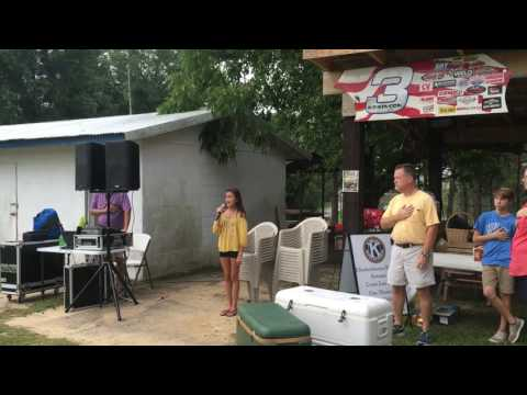 Alyssa Bell sining National Anthem at Fifty-Fifty Fear Factor Fundraiser