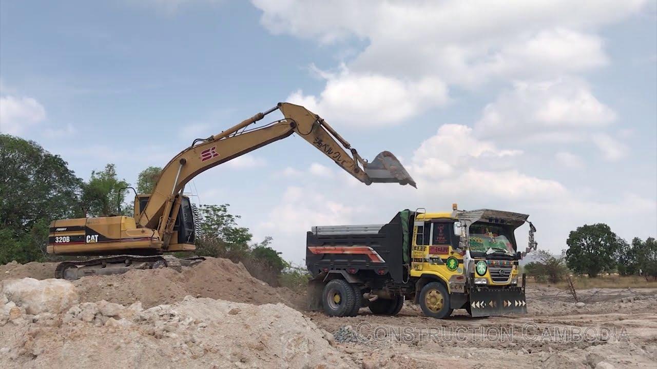 CAT Excavator Loading Trucks អិចជីកដីដាក់ឡានបែន