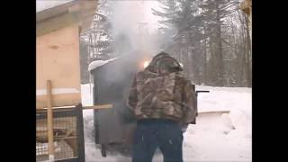 Off the grid loading the outdoor wood boiler 4