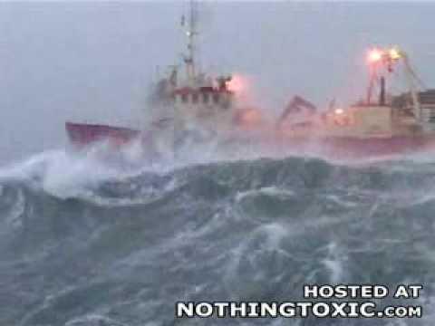Ship in big waves at sea