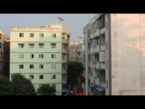 Neighborhood music and construction sounds in Yangon, Burma