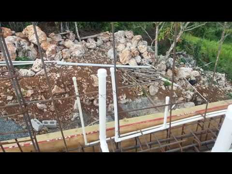 Building a house preparing the deck  plumbing steelwork and electrical