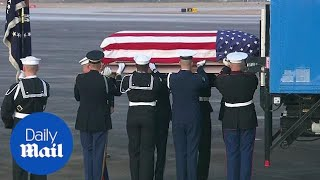 George H.W. Bush's body returns to Texas for his burial