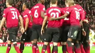 Romelu Lukaku scoring and celebrating his goal with a group hug and a dance.