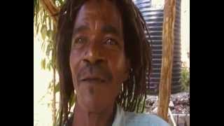 ONE HAND JAMAICAN RASTA MAN SINGS LOVE SONGS/RIDE BIKE/ ROLLS JOINT ETC.