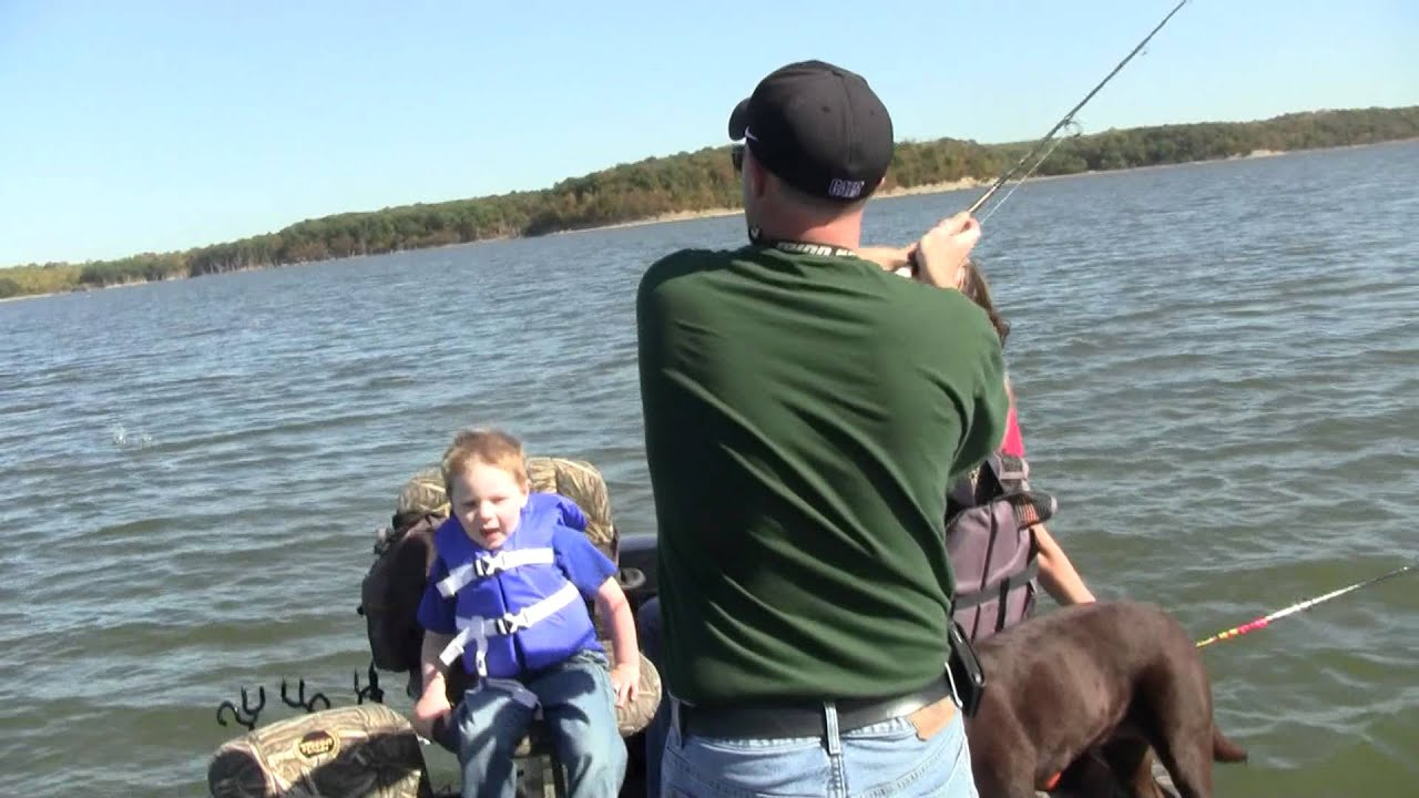 Christina catching white bass as fast as she can get them for Cheney lake fishing report