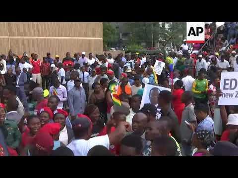 Mnangagwa supporters gather outside Zanu-PF HQ