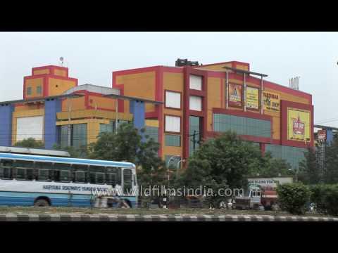 Traffic passes in front of Vardhman Star Shop Mall- Faridabad, Haryana