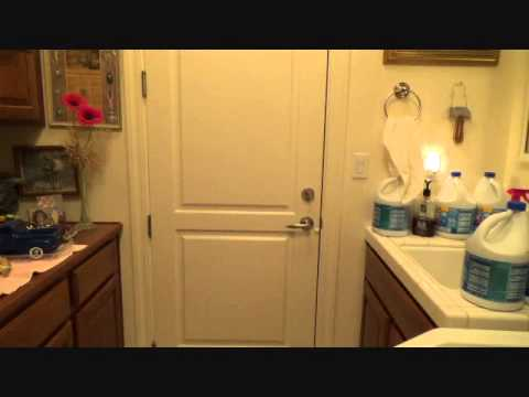 Adjusting a self closing door hinge
