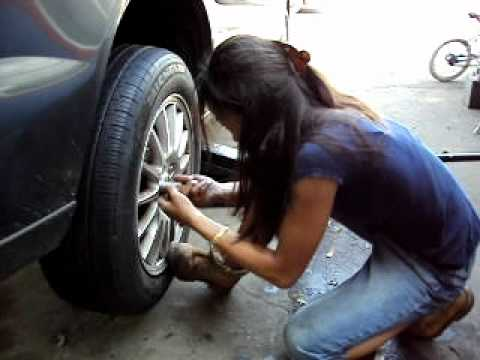 HOTT ASIAN LADY CHANGES TIRES IN A DRESS OR WHAT EVER SHE IS WEARING THAT DAY