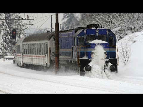 Diesel/electric passenger trains in the snow