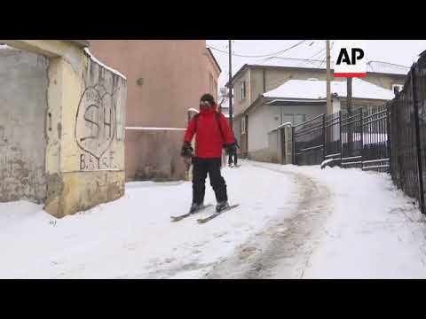 Residents ski through streets following cold snap in Pristina