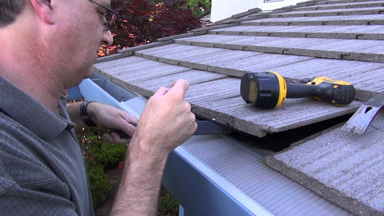 Easyon gutter guard installing on flat tile roof youtube easyon gutter guard installing on flat tile roof solutioingenieria Choice Image