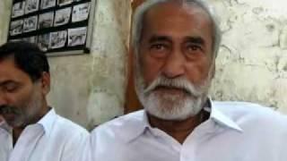 Rashid Morai reciting his poetry in a circle of friends at Sanghar