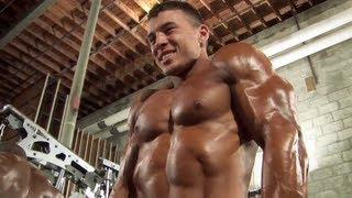 Bodybuilder Mike Carr Pumps Up Backstage