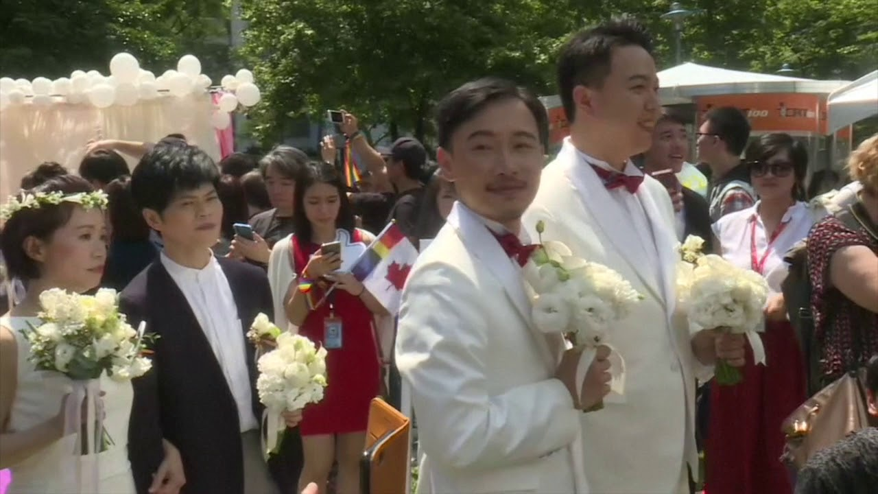 Taiwan holds first gay marriages in historic day for Asia