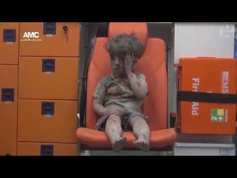 Syrian child pulled from rubble after Aleppo airstrike – video