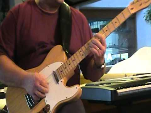 Guitar blues jam with slide.