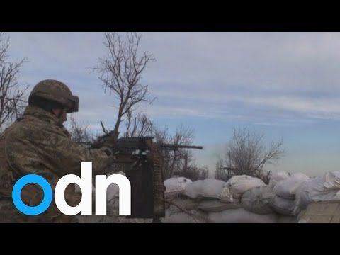 Heavy machinegun fire as Ukrainian soldier is wounded by pro-Russian rebels