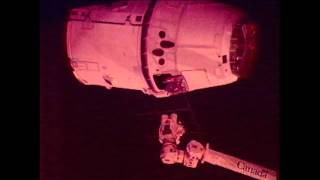 SpaceX Capsule Grappled, Berthed to ISS