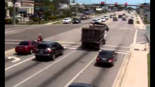 Dump Truck runs red light and performs craziest swerve away from car