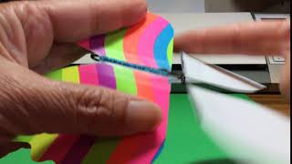 Rubber Band Butterfly Mechanism Being Wound